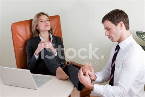 Office Foot Worship by Manager Receiving Foot Stock Photos