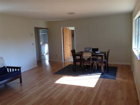 big empty living dining room with light wood floor