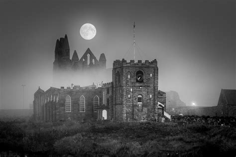 Black And White moon rise at whitby in black and white