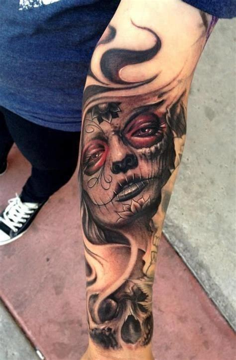 sugar face tattoo designs realistic day of the dead skull on s forearm