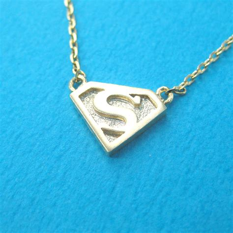 superman logo symbol charm necklace in gold 183 dotoly