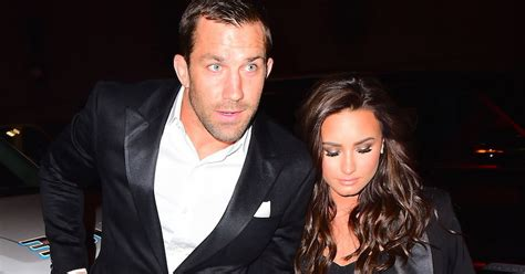 demi lovato and ufc demi lovato and ufc fighter luke rockhold hold hands at