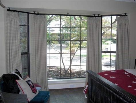 can you hang curtains from the ceiling how to hang curtain rods from the ceiling quora