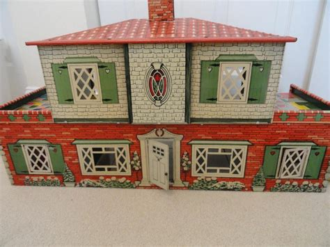 50s metal dollhouse by cohn packed with renwal furniture