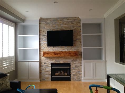 White Cement Fireplace Built In Shelves Also Brown Wooden