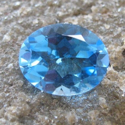 Topaz Swiss 24 Carat Warna Tajam batu permata swiss blue topaz oval 2 65 carat