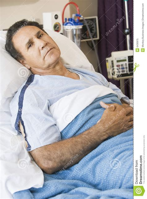 man in hospital bed middle aged man lying in hospital bed royalty free stock photo image 6430975