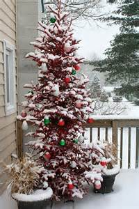 front porch christmas trees front porch christmas entry swags wreaths pinterest