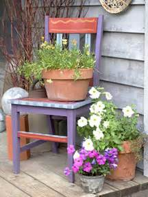 recycling chairs and benches for blooming garden