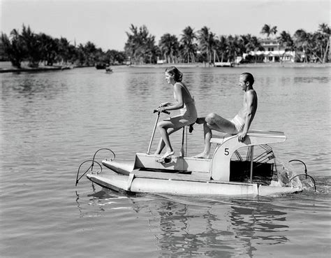 pedal boat pontoon 1940s couple on pontoon pedal boat photograph by vintage