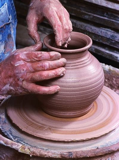 Throwing A Pot | hands throwing a pot on potters wheel potty about clay