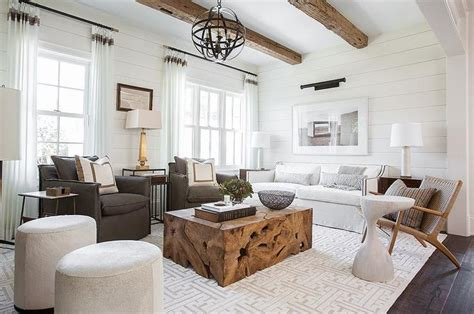 white sofa with wood trim rustic wood beams hang a living room boasting a white