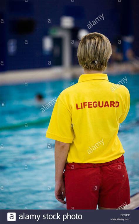 lifeguard swimmers at an indoor swimming pool in the stock photo royalty free