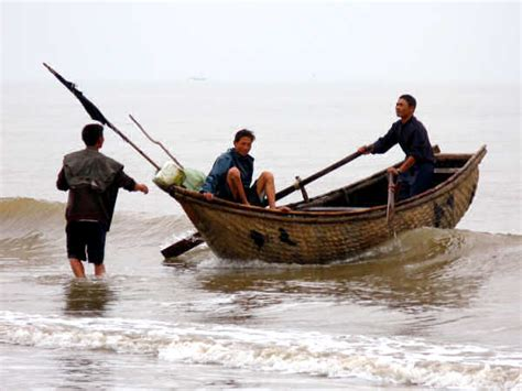 boat with a very fine net north vn coastal boats the wooden boats of the north