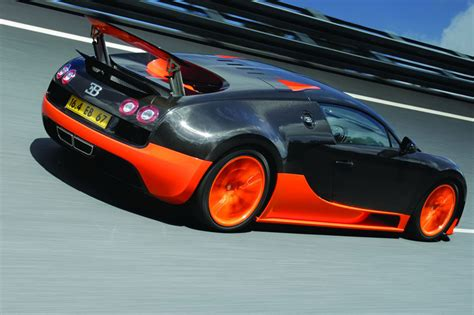 black and orange bugatti photos bugatti veyron 2011 from article guinness record