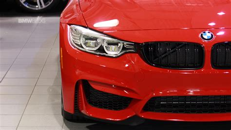 red bmw m4 bmw m4 in ferrari red looks gorgeous