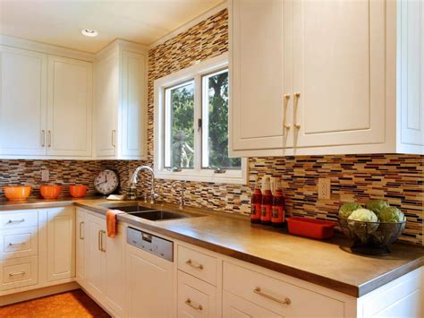 kitchen with white cabinets backsplash and bronze accents photo page hgtv