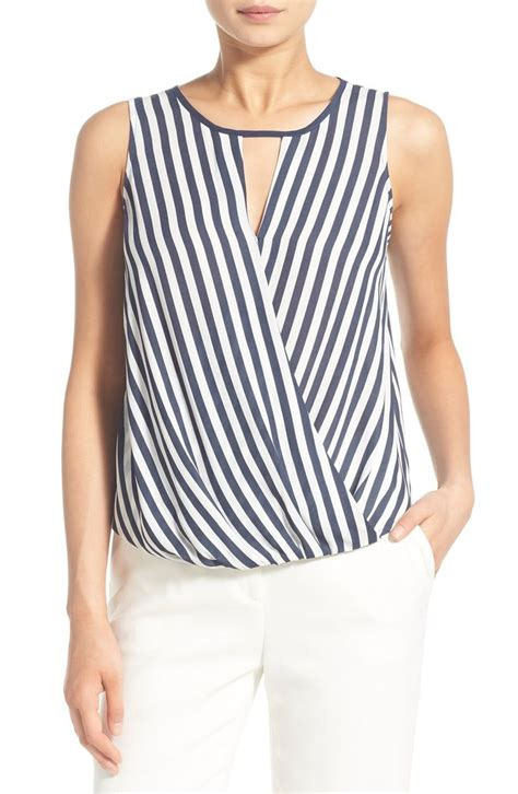 Blouse Atasan Blue Stripe Flowy Hv nautical stripes in blue and white adorn this flowy tank that pairs perfectly with white denim