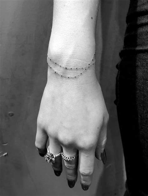 wrist bangle tattoos best 25 wrist bracelet tattoos ideas on