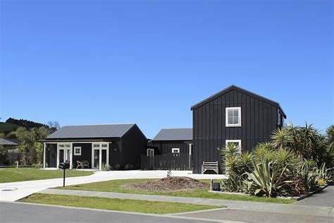 house and home architecturally designed barn inspired ply batten home