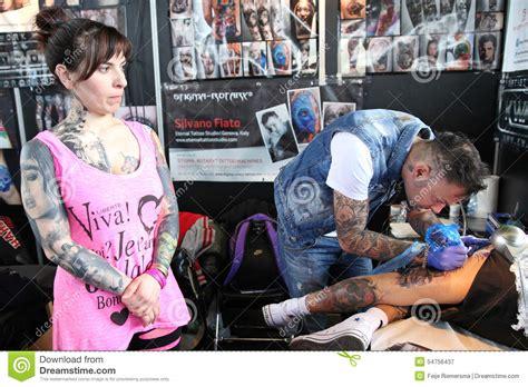 working man tattoo getting a at a studio editorial