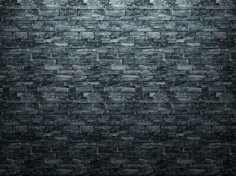 Irregular dark grey stone tiles seamless texture