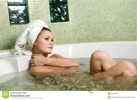 bathroom nud beautiful woman in a bathroom royalty free stock photo