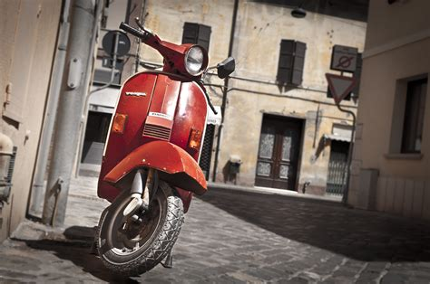 italy falling out of love with mopeds scooters due to