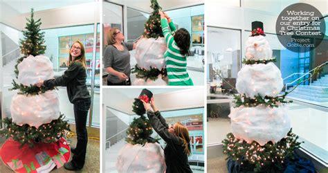 a green christmas tree some creativity a white snowman