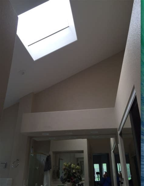lowering vaulted bathroom ceiling with skylight