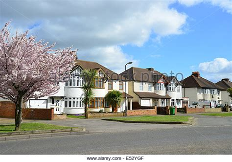 buy a house in slough street scene with semi detached houses in spring cippenham lane stock photo picture