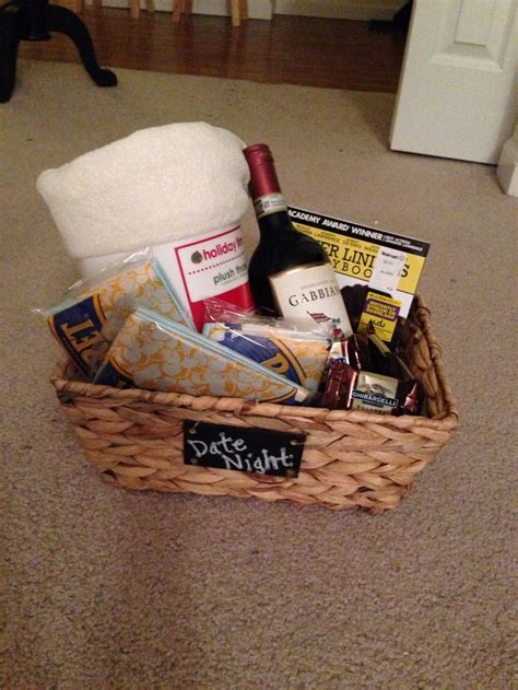 awesome holiday grab bag gifts grab bag gift idea quot date quot includes a basket filled with a throw blanket wine