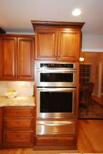 kitchen aid cabinets starmark cherry cabinets with kitchenaid oven microwave combo above warming drawer this unit is