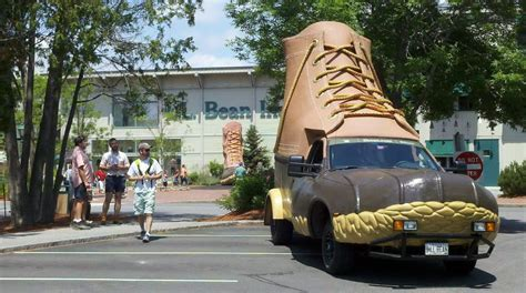 strange 2 story ll bean boot shaped truck in front