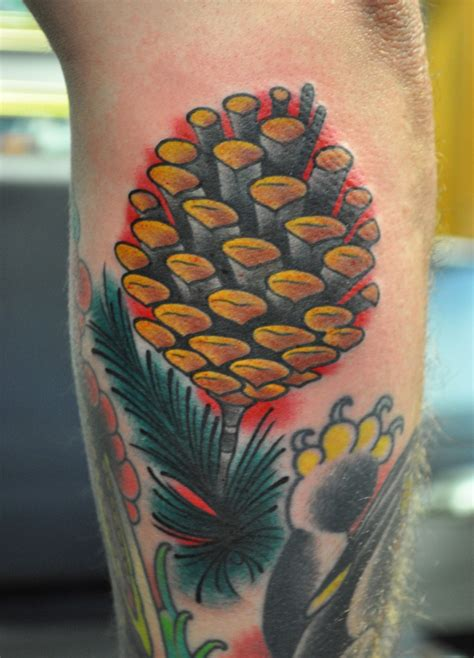 living arts tattoo pinecone on some piney dude by josh hoffman living