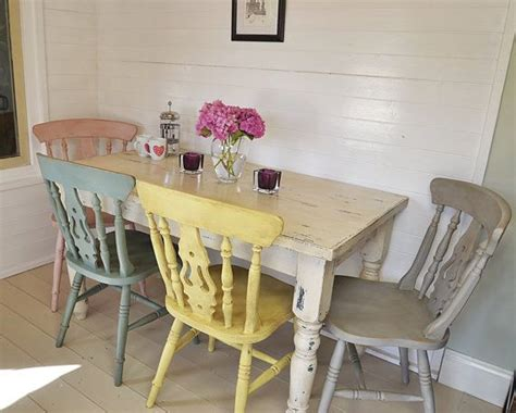 shabby chic farmhouse dining table with four multicoloured chairs f