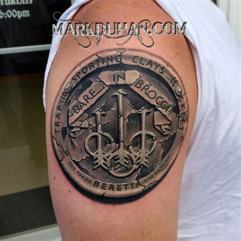 stone beretta logo by mark duhan tattoonow