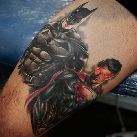 batman superman tattoo batman and superman on leg