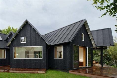 houses with black roofs black house with metal roof homes pinterest house layout and village houses