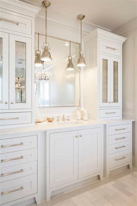 white washstand with mirrored cabinets and drawers