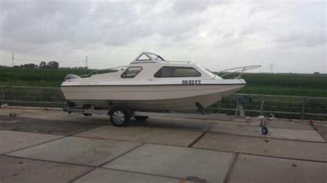 kajuitboot polyester polyester kajuitboot 40 pk mariner 4 takt incl trailer