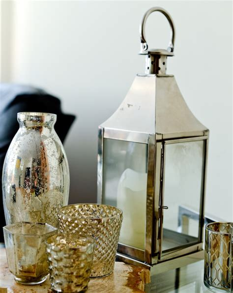 accessorize your end table with silver vases and votives