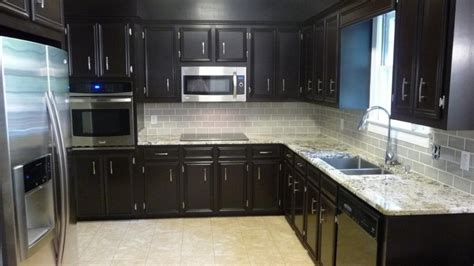 dark kitchen cabinets with light granite countertops dark cherry cabinet with white backsplash ideas for