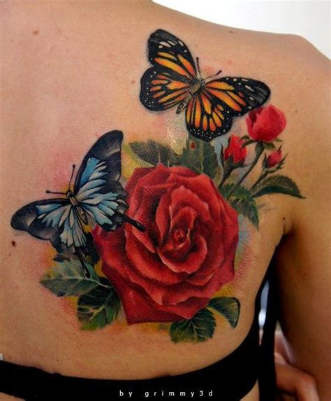 3d tattoo designs flowers two butterflies pose with a flower in this