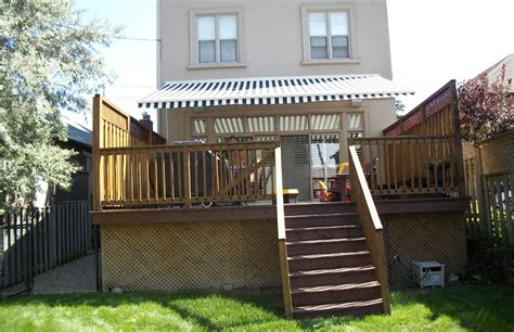 residential striped awning deck rolltec