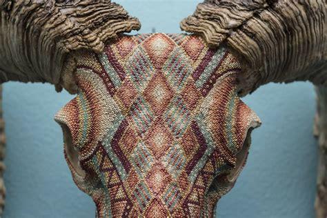 beaded skull detailed beadwork converts these animal skulls into mystic