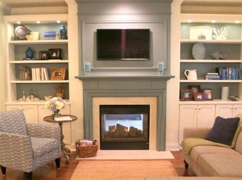 painted mantel with bookcases tv fireplace staging shelves and mantels