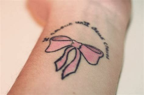 pink ribbon tattoo on wrist