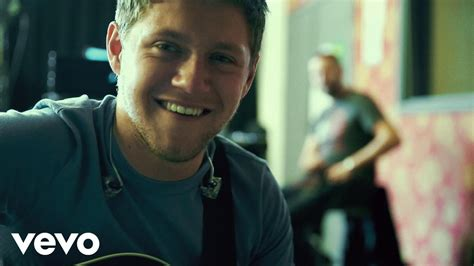 heres the irish model niall horan had a cheeky kiss with its niall horan premieres behind the scenes lyric video for