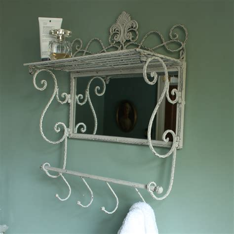 Wall Mirror With Hooks And Shelf by Metal Wall Shelf With Hooks And Mirror Melody Maison 174